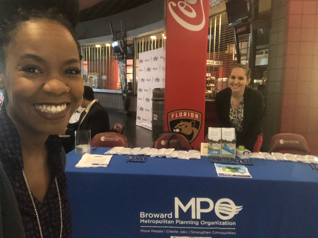 Two MPO staff greeting students at Claim Your Future Showcase