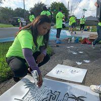 Yvette Colbourne painting sidewalk enhancement