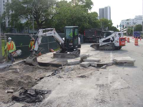 Removal of existing concrete sidewalk on the north side of NW 2nd Street between NW 1st Avenue and Andrews Avenue