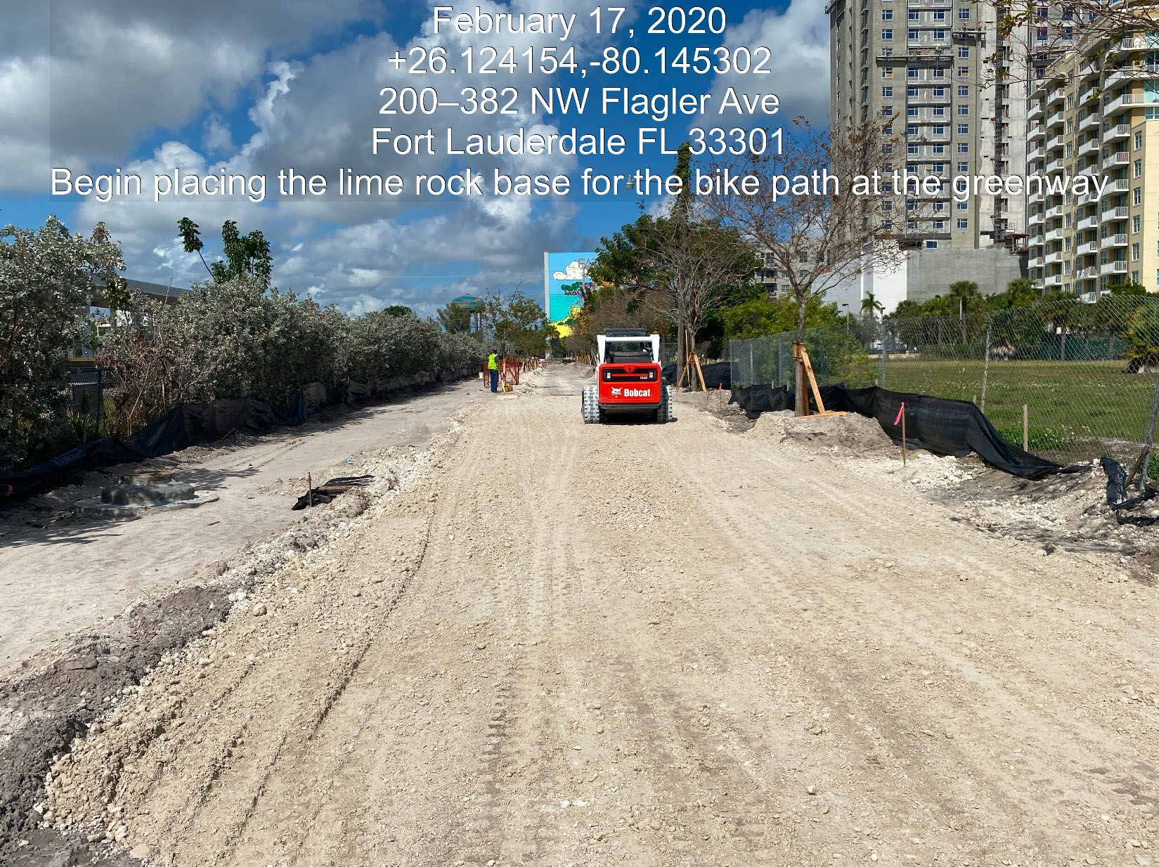 Placement of limerock base material on Flagler Avenue.
