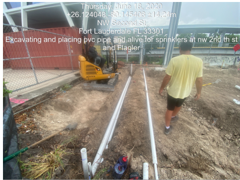 Installation of irrigation pipes on the SW corner of NW 2nd Street and Flagler Avenue