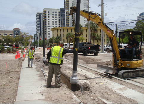 Installation of pedestrian light poles on the north side of NW 4th Street.
