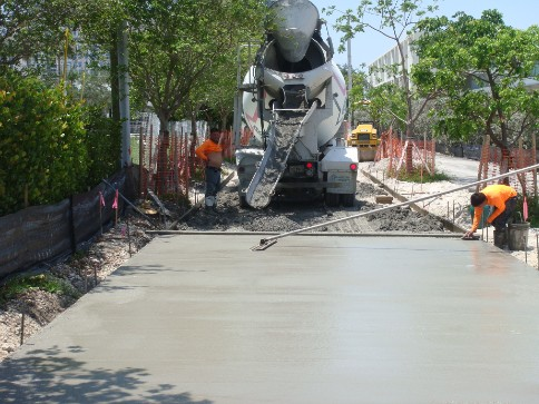 Pouring of the 15' concrete path on Flagler Avenue.
