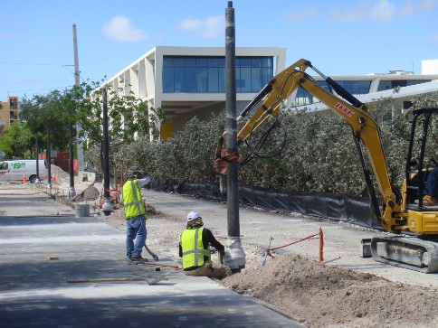 Installation of pedestrian light poles on Flagler Avenue.