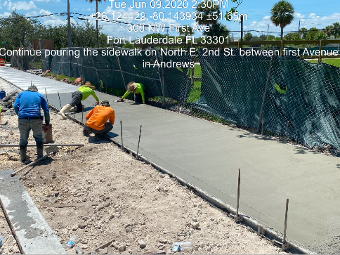 Pouring the concrete sidewalk on the north side of NW 2nd Street between NW 1st Avenue and Andrews Avenue
