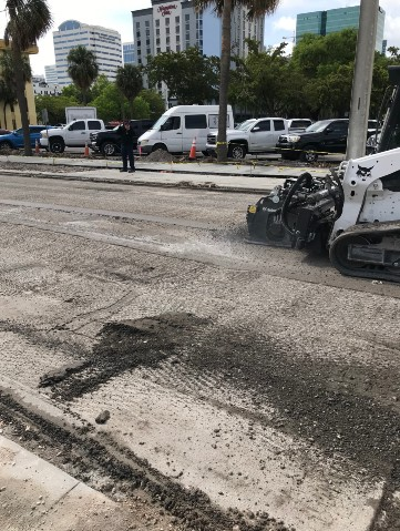 Milling the existing asphalt on NW 4th Street